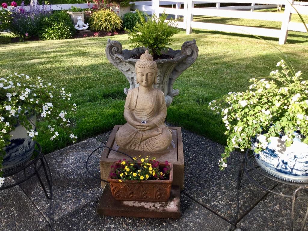 Buddha statue in Sandra Bazant's garden.