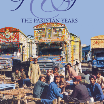 Geckos & Guns: The Pakistan Years by Sharon Bazant shows three decorated Pakistani trucks with their drivers sitting around drinking tea. A bright blue sky is behind them.